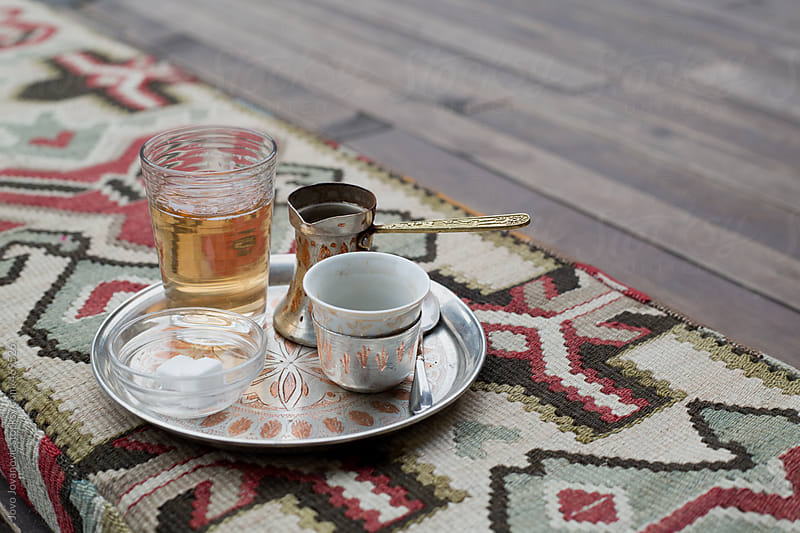 Traditional Turkish coffee set on an ethnic table rug by Jovo Jovanovic for Stocksy United