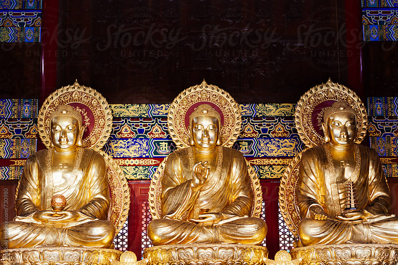 golden buddha by jira Saki for Stocksy United