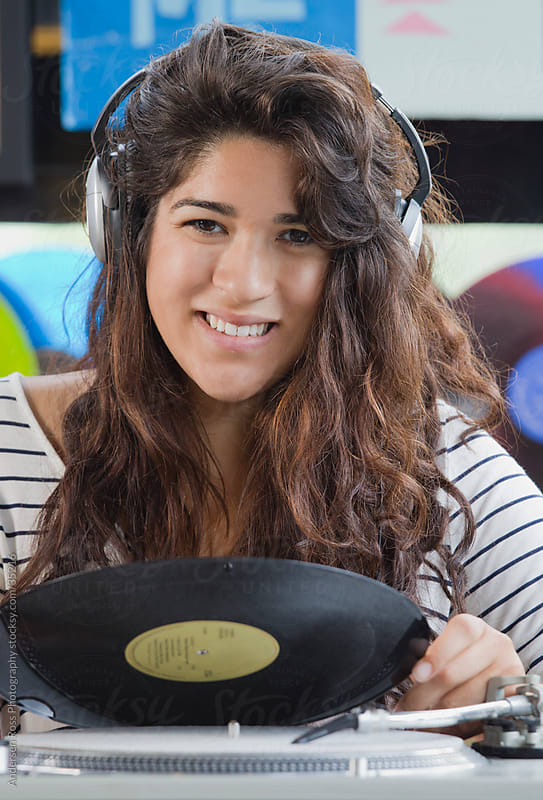 Portrait of young woman holding record by Andersen Ross Photography for Stocksy United