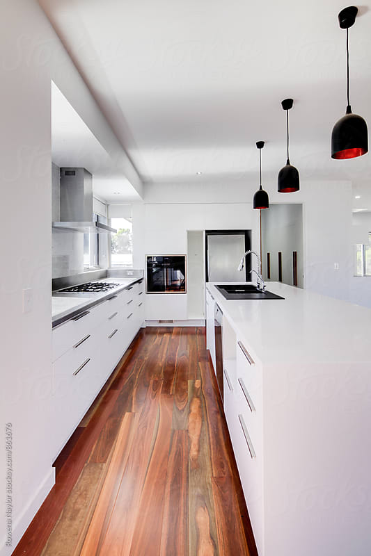 Brand new kitchen in modern home by Rowena Naylor for Stocksy United