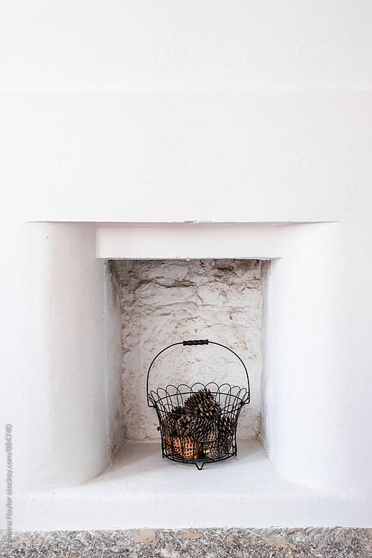 Rustic cottage fireplace by Rowena Naylor for Stocksy United