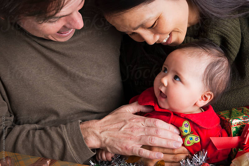 Smiley Asian baby girl and parents by yuko hirao for Stocksy United