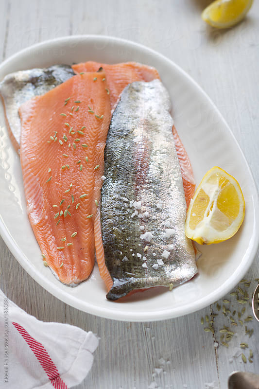 Salmon trout fillet by Noemi Hauser for Stocksy United