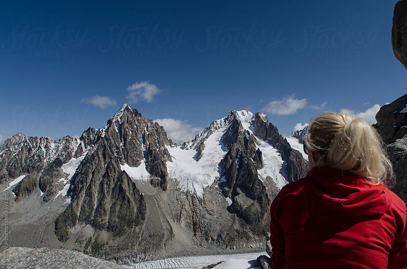 Young woman taking in the view of the mountains by Neil Warburton for Stocksy United