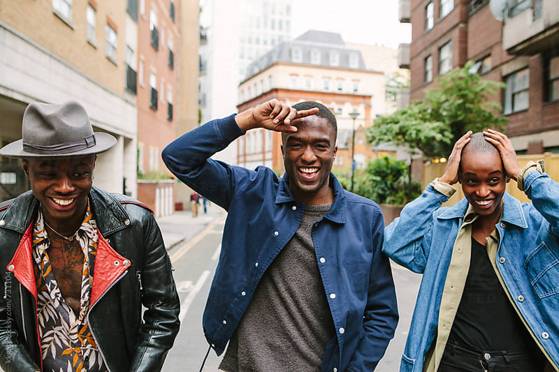 Three Fashionable friends in an urban setting by kkgas for Stocksy United