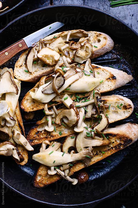 Mushroom toasts: Mushroom toasts in a skillet.  by Darren Muir for Stocksy United
