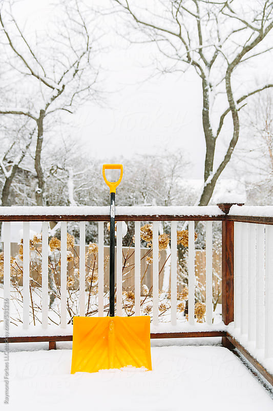 Yellow Snow Shovel by Raymond Forbes LLC for Stocksy United