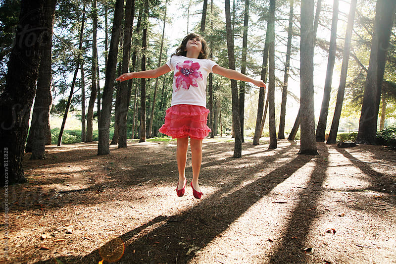 Young Girl Levitating In the Forrest by Dina Giangregorio for Stocksy United