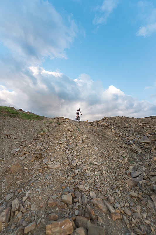 Man mountain biking offroad by RG&B Images for Stocksy United
