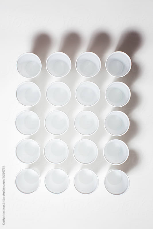 White plastic cups filled with water... by Catherine MacBride for Stocksy United