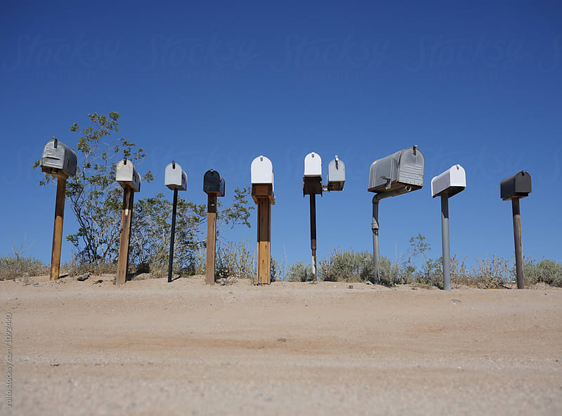 Several mailboxes near deserted road by rolfo for Stocksy United