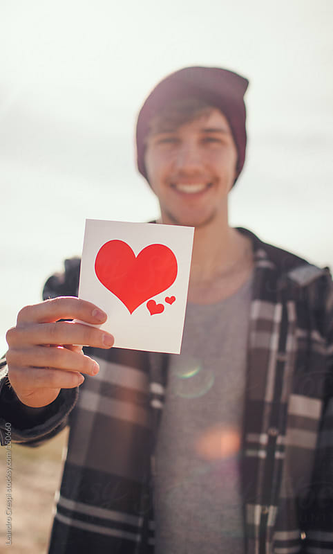 Man holding heart image by Leandro Crespi for Stocksy United