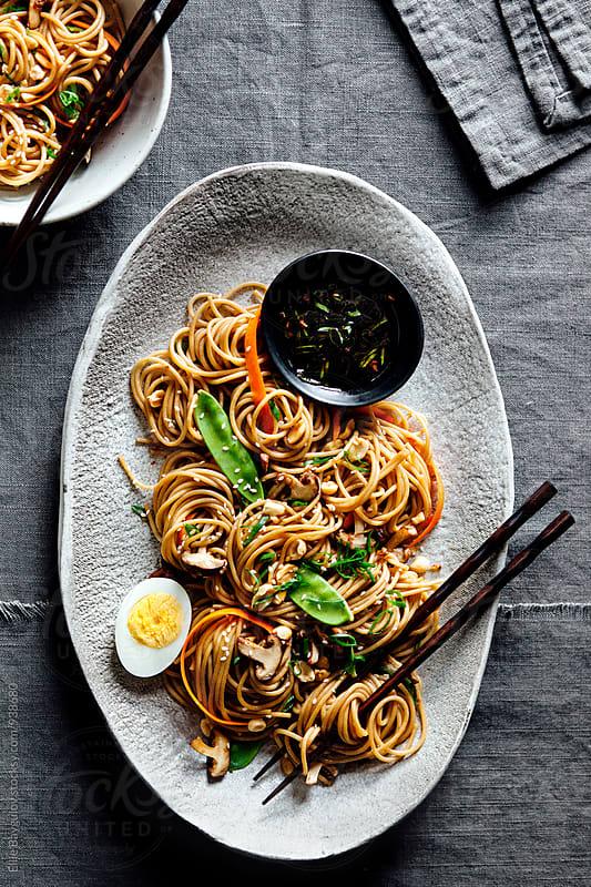 Soba noodle platter by Ellie Baygulov for Stocksy United