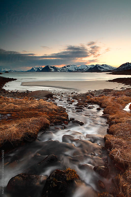 A small river flows into Rorvika Beach in Lofoten by Marilar Irastorza for Stocksy United