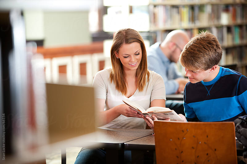 Library: Two Teens Working Together on Research by Sean Locke for Stocksy United