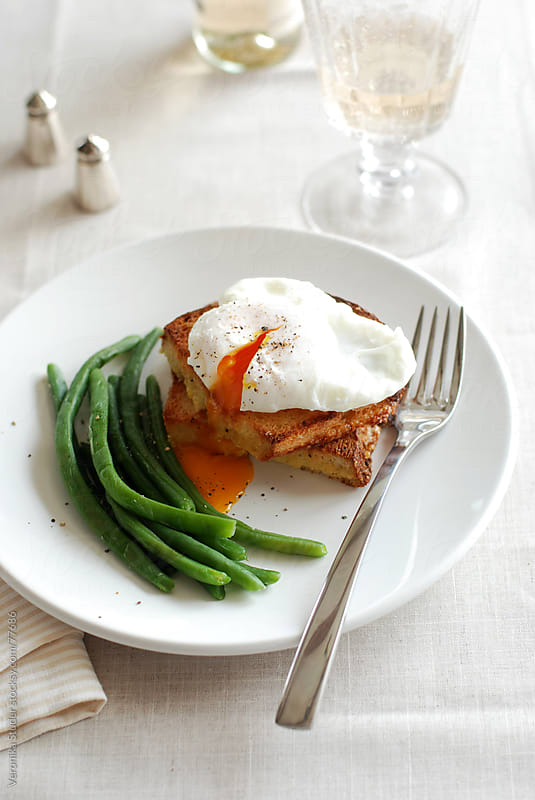 Poached egg with green beans by Veronika Studer for Stocksy United