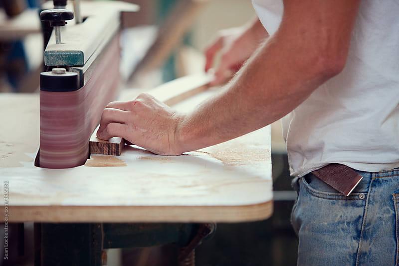 Woodworking: Using Belt Sander To Smooth Trim Piece by Sean Locke for Stocksy United