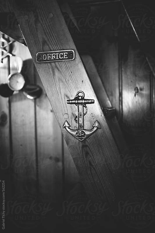 Vintage anchor and office signs by Gabriel Tichy for Stocksy United