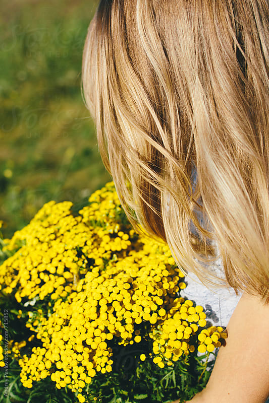 Closeup of blonde girl holding big bouquet of wildflowers by Andrey Pavlov for Stocksy United