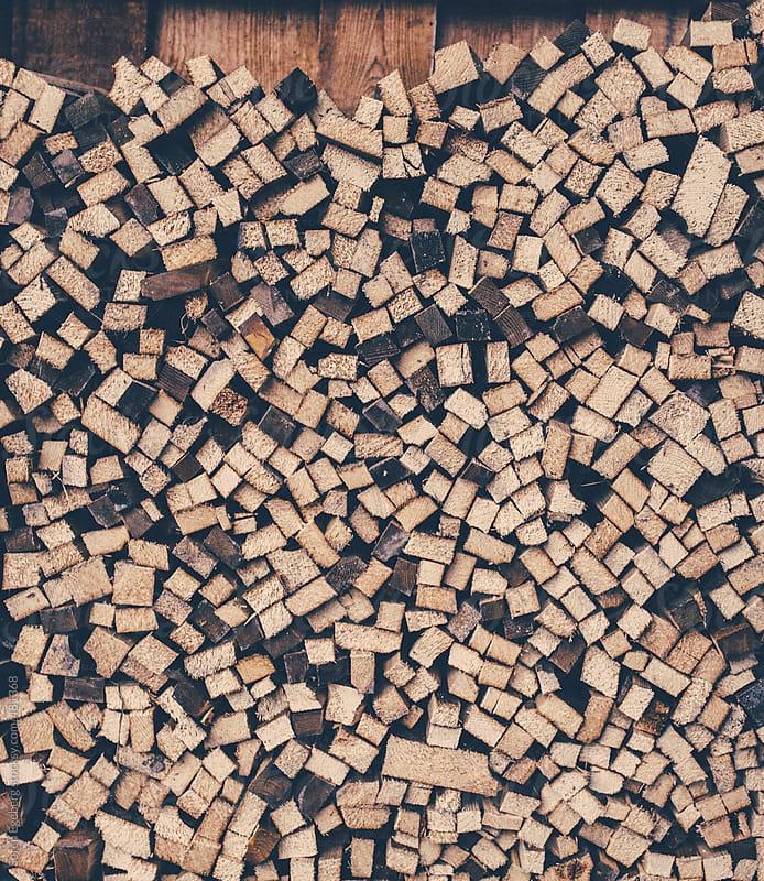 Dry stacked fire wood logs outside by Soren Egeberg for Stocksy United
