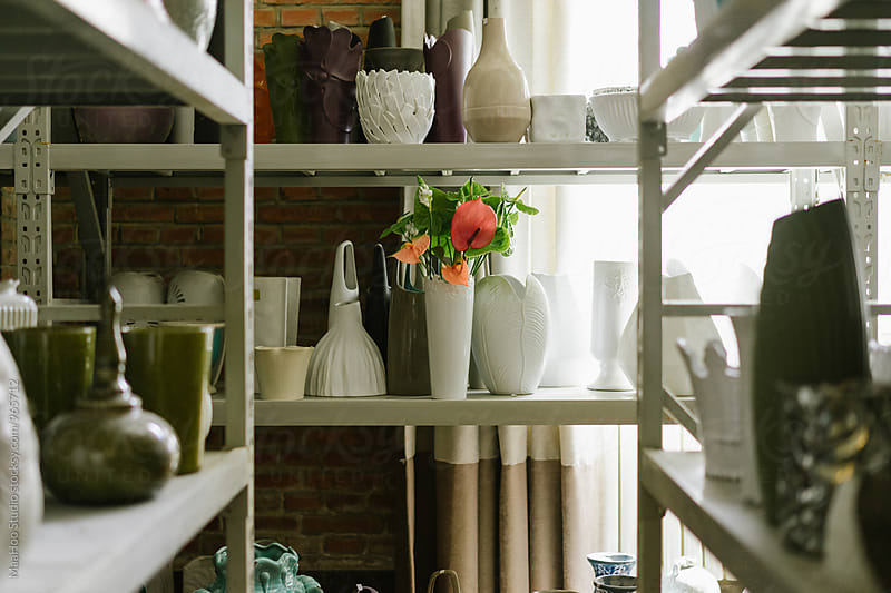 Shelf with empty vases and bouquet of flower by MaaHoo Studio for Stocksy United