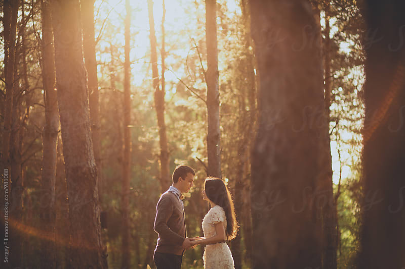 Summer sunset and the young beautiful couple by Sergey Filimonov for Stocksy United
