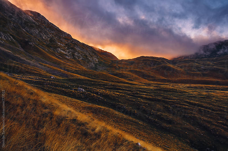 Dramatic sky above the mountains in the morning by Dimitrije Tanaskovic for Stocksy United