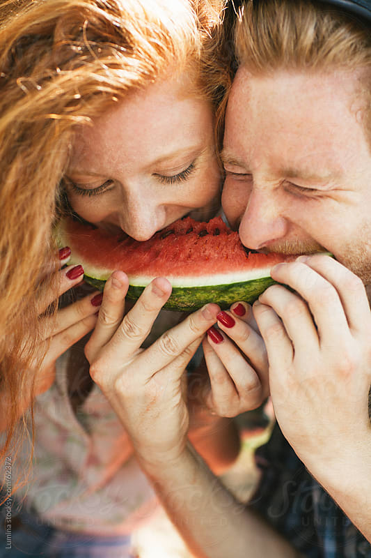 Couple Eating a Watermelon by Lumina for Stocksy United