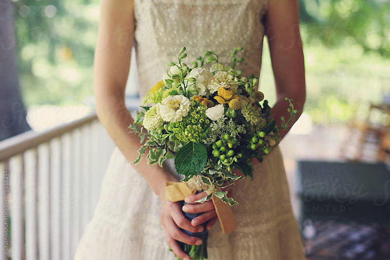 Bride With Wedding Flowers by ALICIA BOCK for Stocksy United