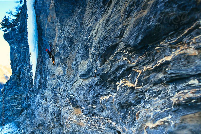 Man climbing mixed rock and ice in the mountains by Soren Egeberg for Stocksy United