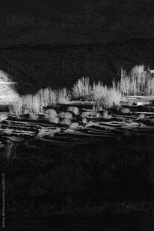 Black and white image of the dramatic landscape of Mustang, Nepal. by Shikhar Bhattarai for Stocksy United