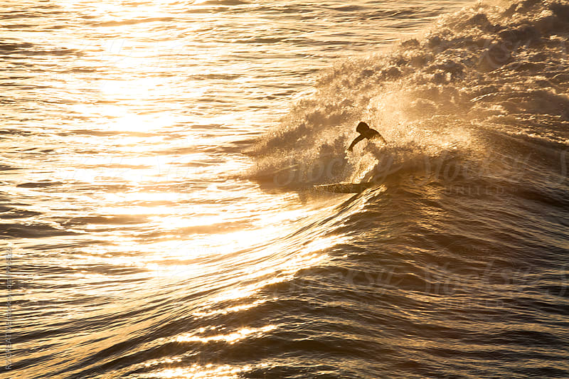 Surfer with early morning light. by Robert Zaleski for Stocksy United