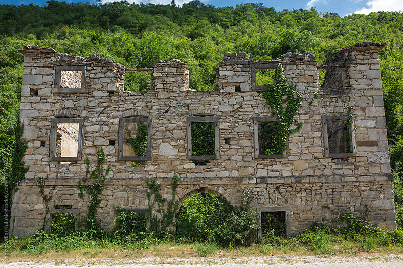 Old stone abandoned house in ruins covered with green leaves by Sanja (Lydia) Kulušić for Stocksy United