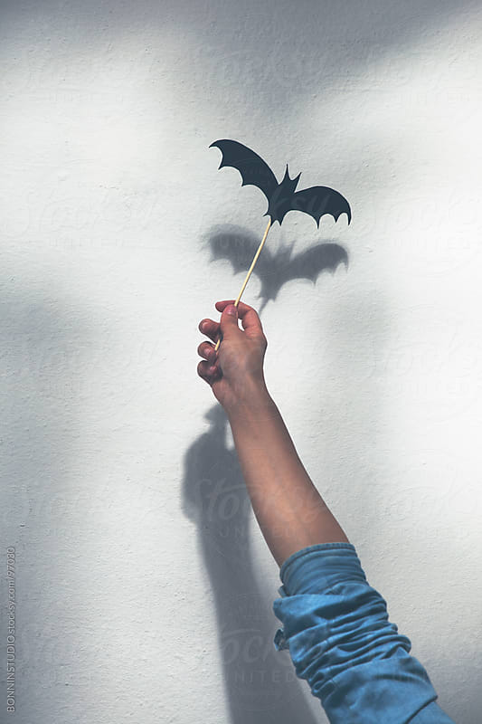 Halloween decoration.  Making terrifying shadow puppet. by BONNINSTUDIO for Stocksy United