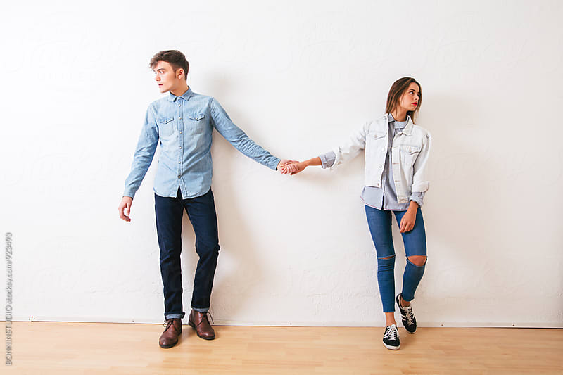 Couple wearing denim clothes holding hands. by BONNINSTUDIO for Stocksy United