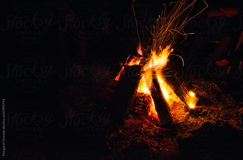 campfire with sparks by Margaret Vincent for Stocksy United