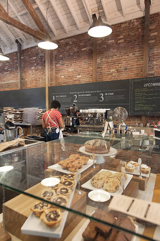 Barista Working in Stylish Bakery by Julien L. Balmer for Stocksy United