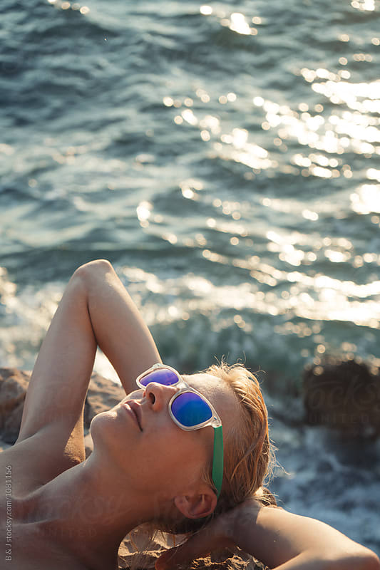 Portrait of young girl sunbathing by B & J for Stocksy United