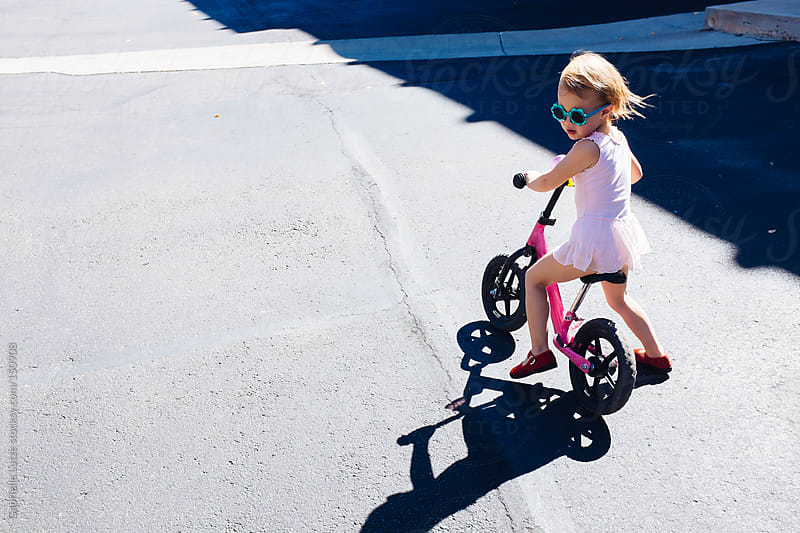 Cute Little Girl Riding a Pink Bike by Gabrielle Lutze for Stocksy United