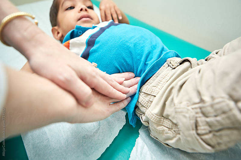 A little boy being examined by a doctor  by Alicja Colon for Stocksy United