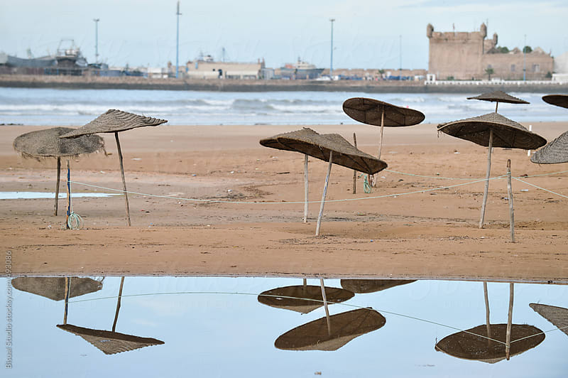 Umbrellas on the beach by Bisual Studio for Stocksy United