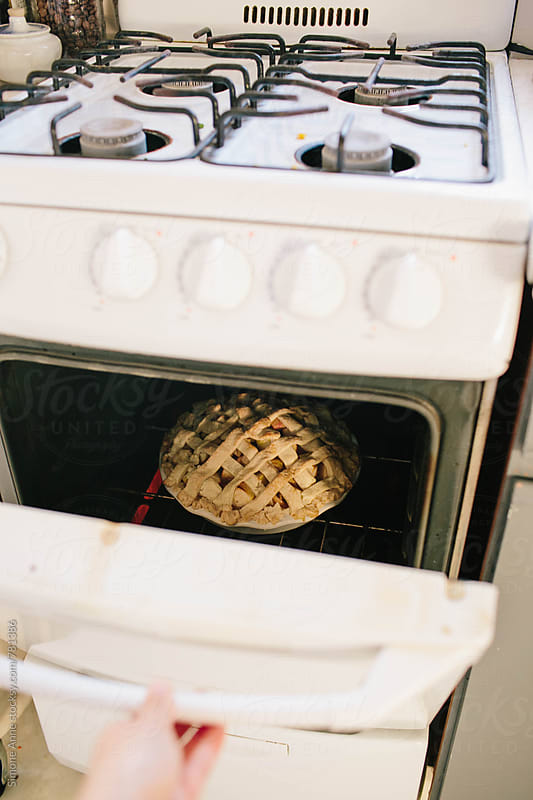 Baked pie in white vintage oven by Simone Anne for Stocksy United
