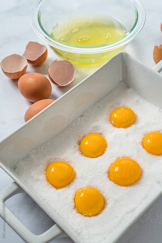 Preparing Cured Egg Yolks by suzanne clements for Stocksy United