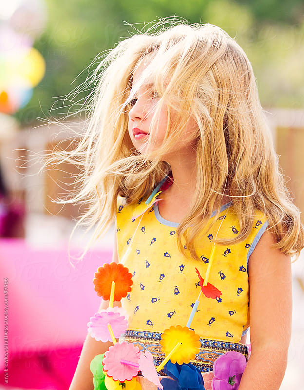 Portrait of beautiful blonde young girl gazing into the distance by anya brewley schultheiss for Stocksy United