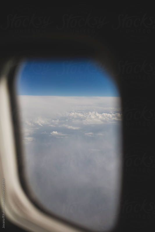 Clouds  from an airplane window by Jovana Rikalo for Stocksy United