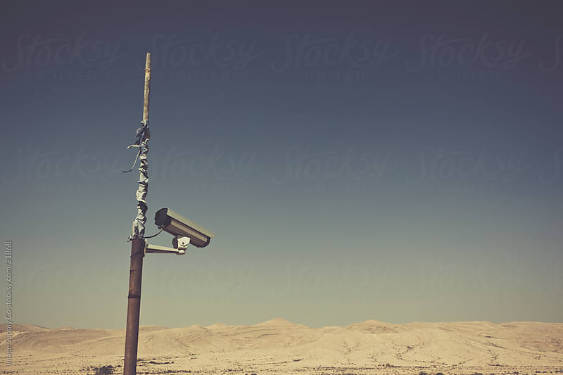 CCTV camera overlooking empty desert. by Image Supply Co for Stocksy United