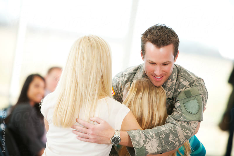 Airport: Family Welcomes Home Miltary Dad by Sean Locke for Stocksy United