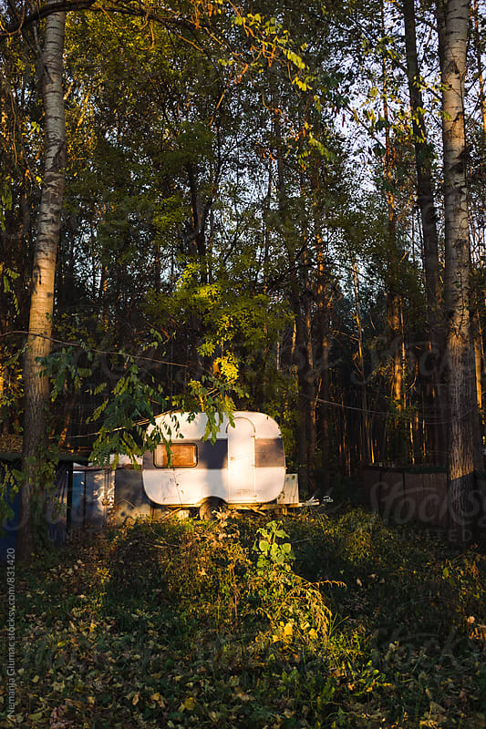 Camping Trailer in the Forest at Sunset by Nemanja Glumac for Stocksy United