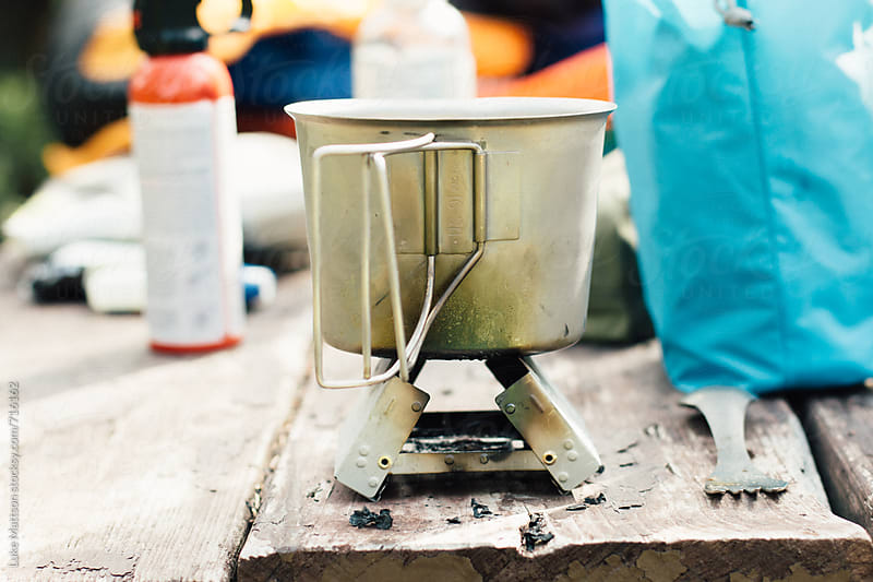 Metal Backpacking Stove And Canteen Cup by Luke Mattson for Stocksy United