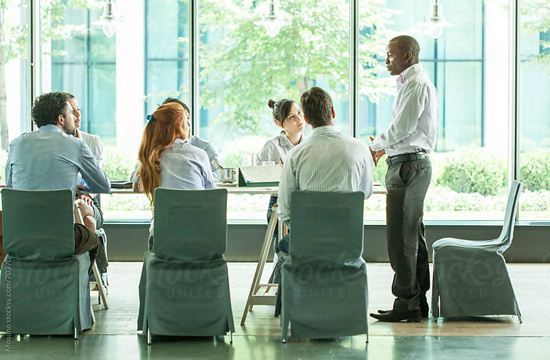 Group Of People in a Business Meeting by Mosuno for Stocksy United